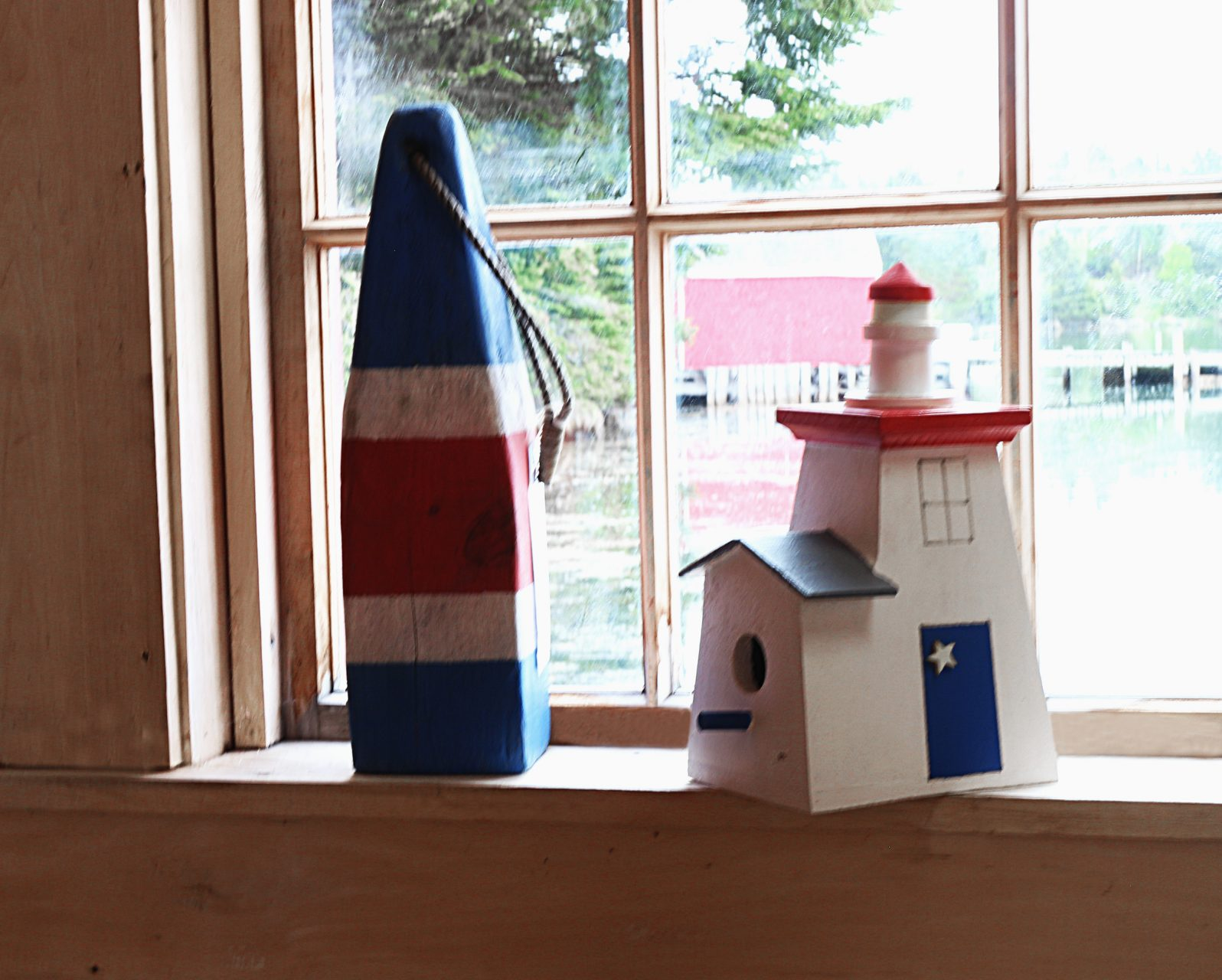 lighthouse birdhouse, $25. , small buoy, $25.