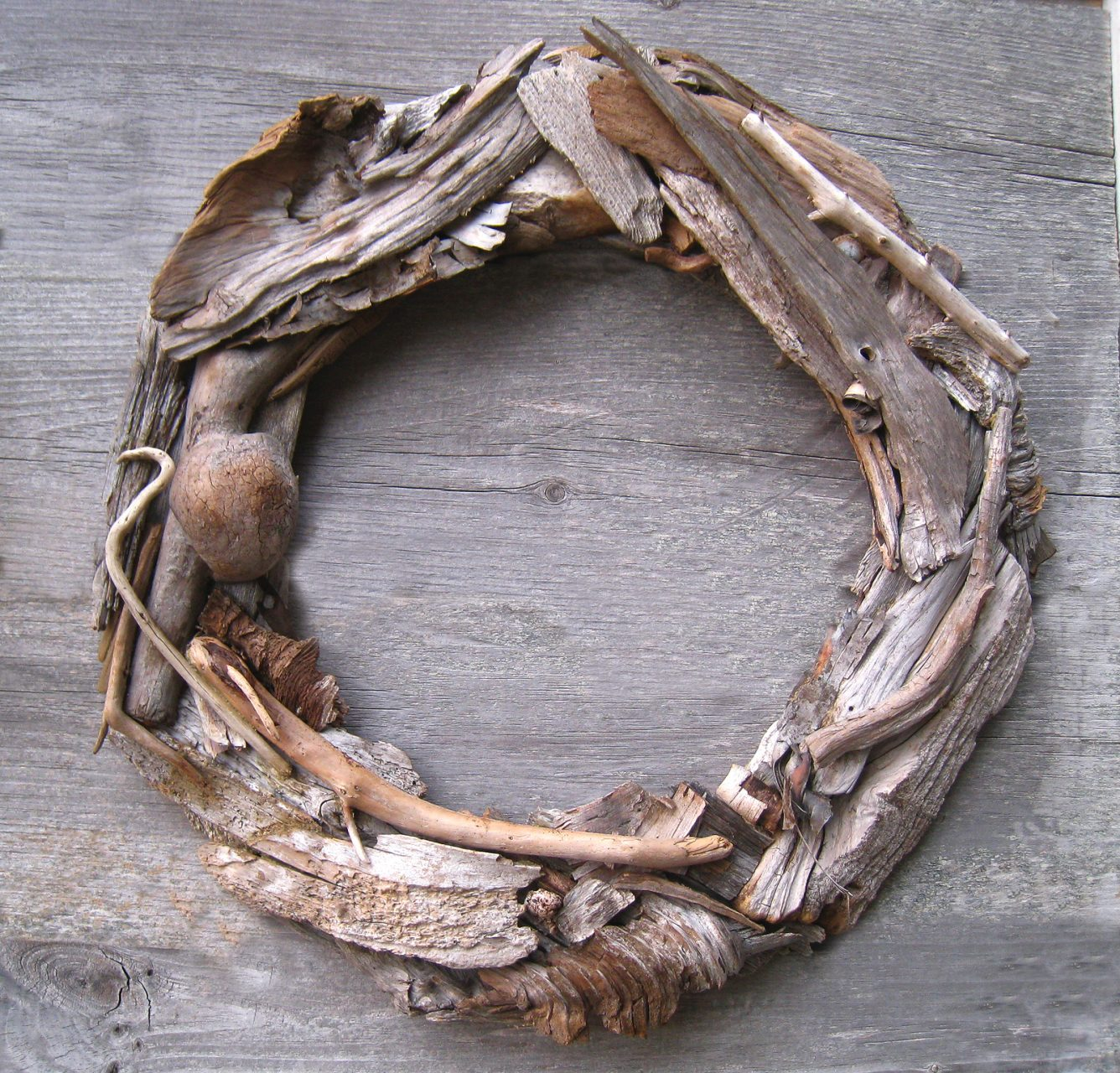"Driftwood wreath, 17"". $70. smaller wreath, 12"" ,$40."