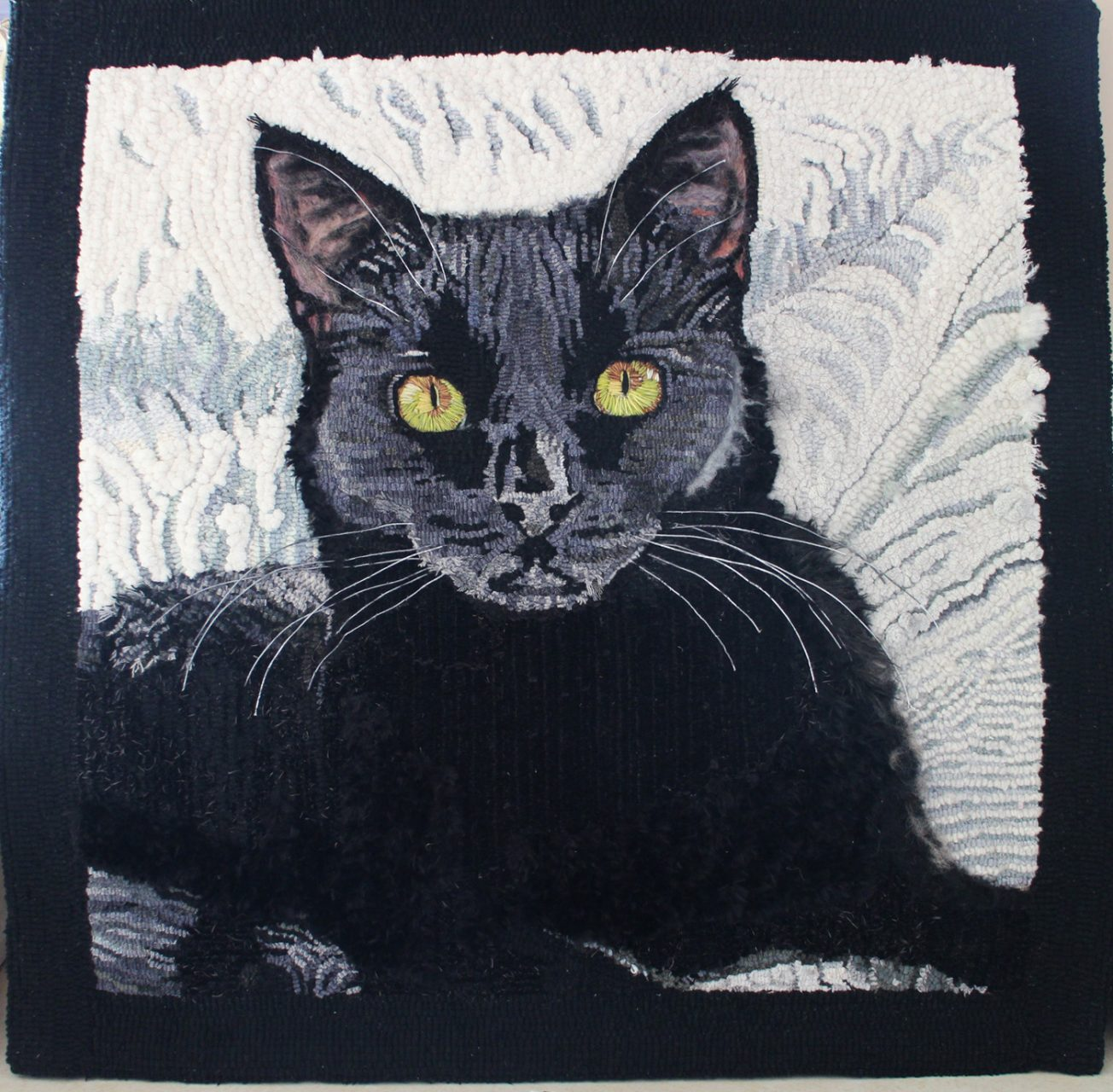 """KHALESSI"", Khalessi is a member of the family. This mat was hooked with various fluffy yarns and velvet. The ears are felted; the whiskers are made of cotton covered wire and the eyes are made of thread. NFS"